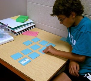 student playing a matching word game