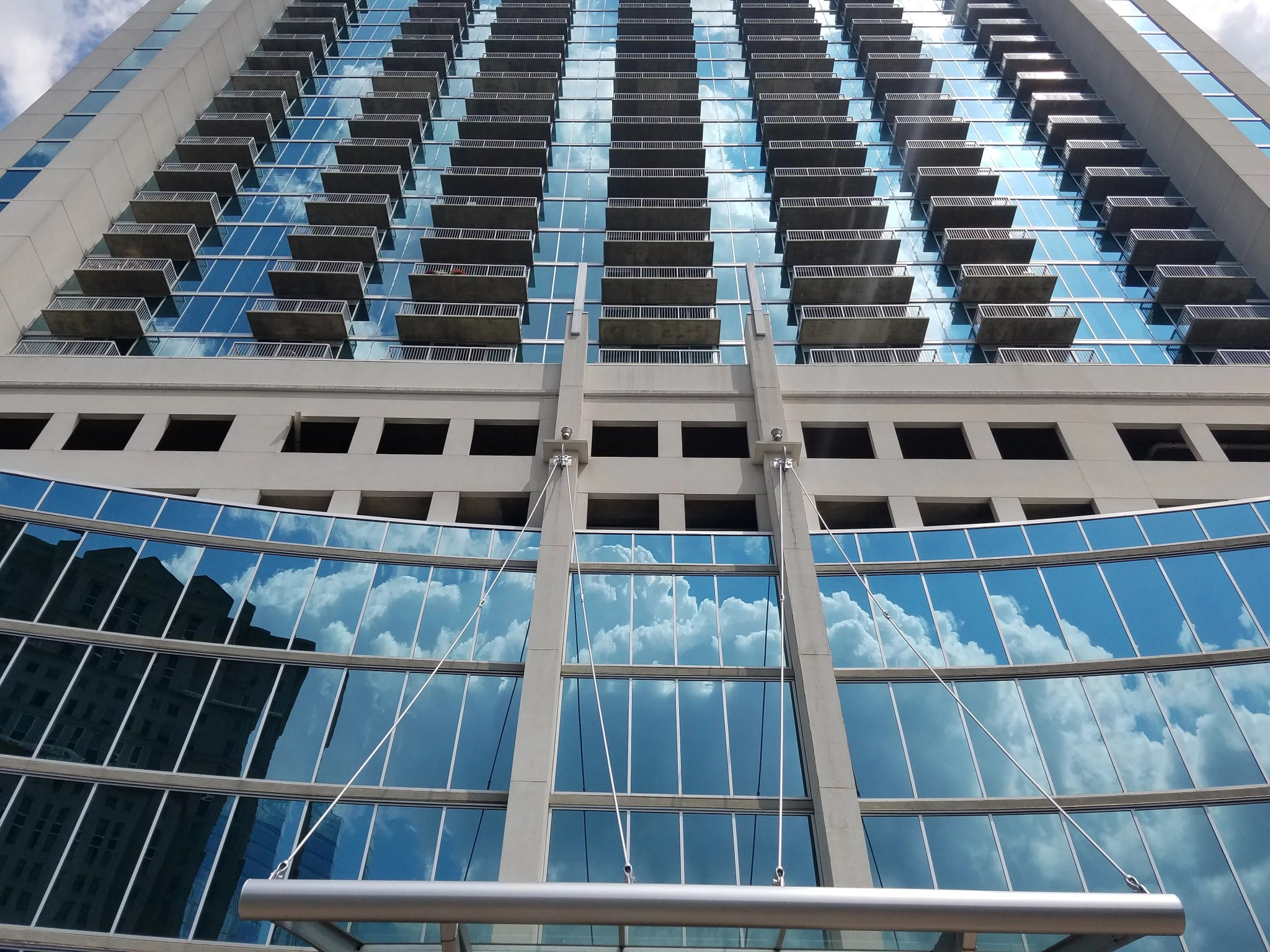 The Realm Condominium of Buckhead view of exterior of building looking up to the sky