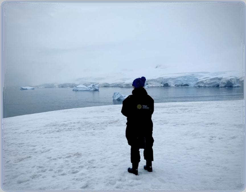 Dee Newell standing on Antarctica
