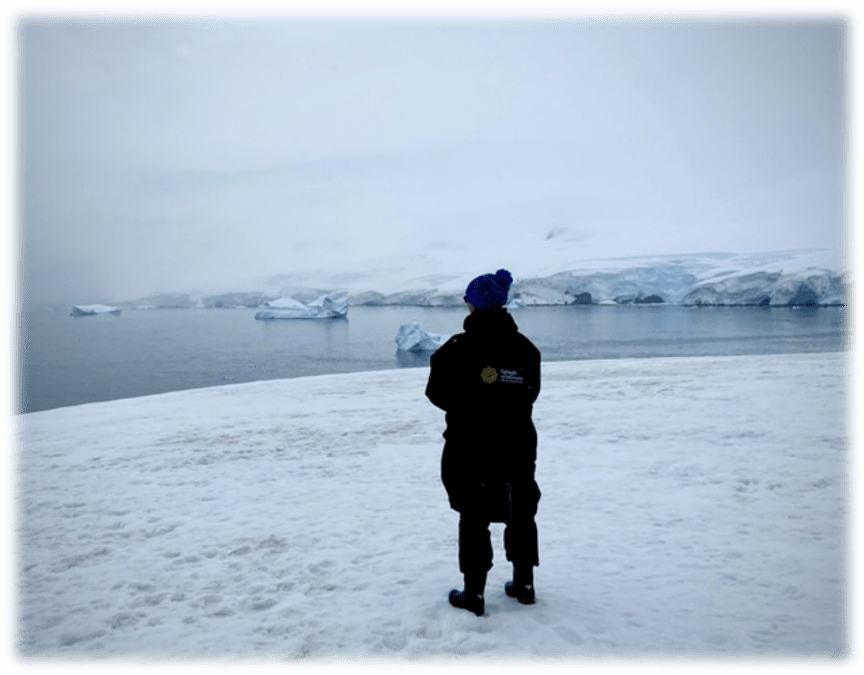 Dee Newell standing on Antarctica