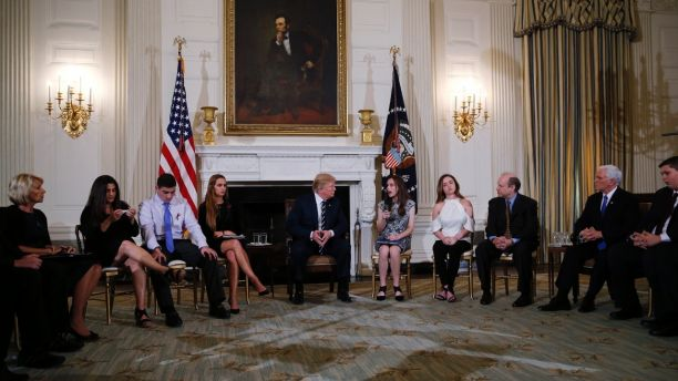 Trump with teachers and victims of school shootings