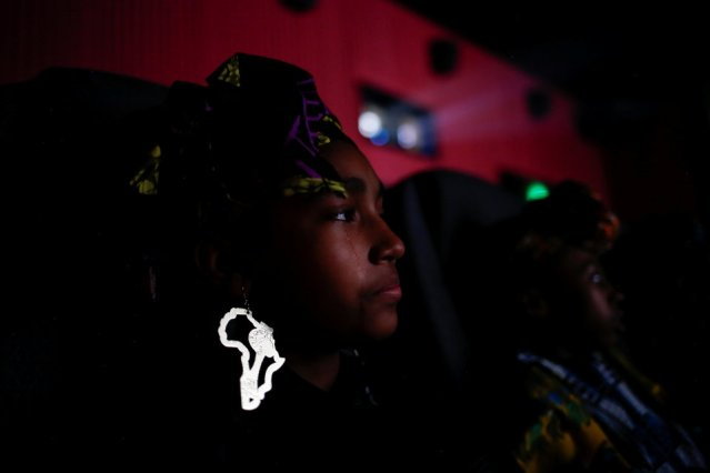 """Ron Clark Academy 6th grader Destiny Ellington, 12, sheds a tear as she joins classmates in watching the film """"Black Panther"""" at Atlantic Station theaters in Atlanta"""