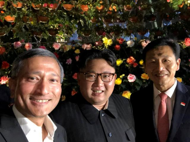 Singapore's Foreign Minister Vivian Balakrishnan, North Korean leader Kim Jong Un, and Singapore's Education Minister Ong Ye Kung pose for a photo in Singapore