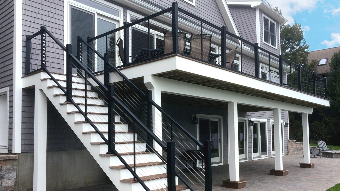Atlantis Rail Systems Steel Cable Railing Home | Staircase Steel Railing Designs With Glass | Glass Panel Wooden Handrail | Modern Style | Stair Glass Void | Curved | Metal