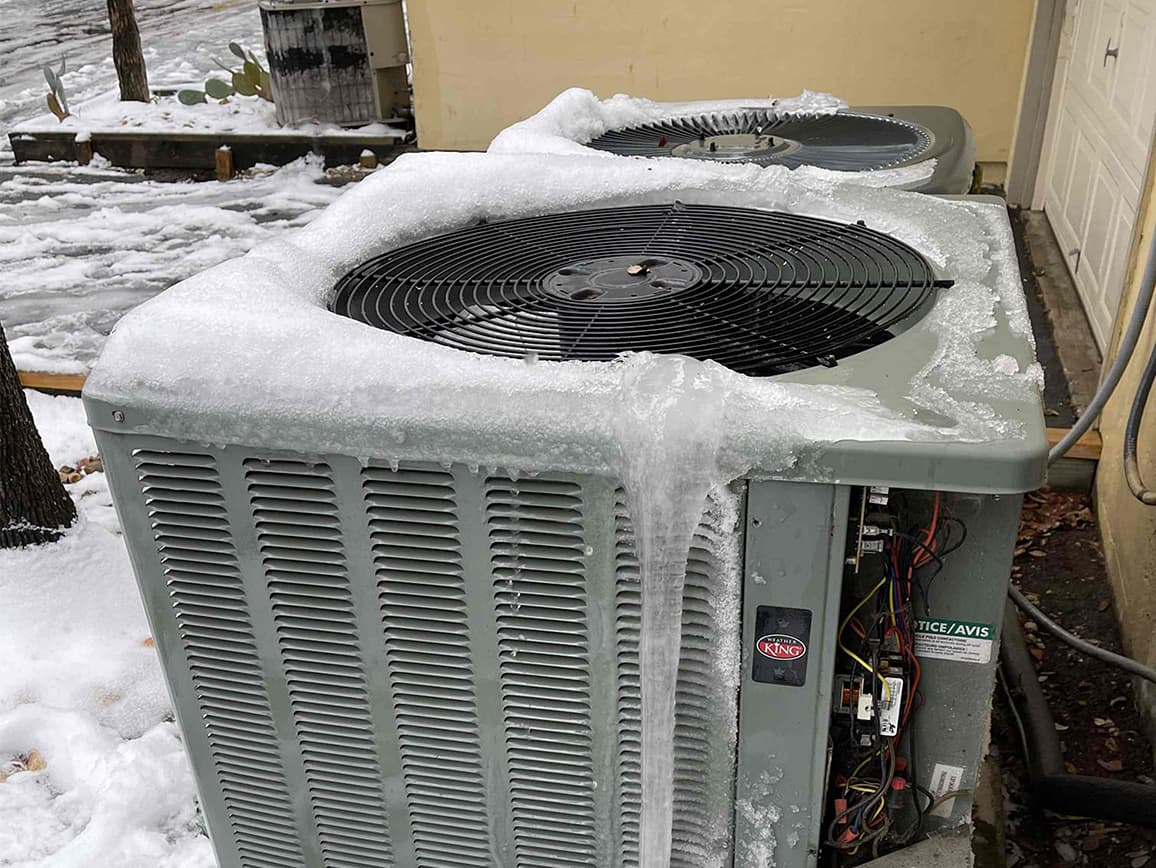 ice covered ac condensers in winter outside commercial building