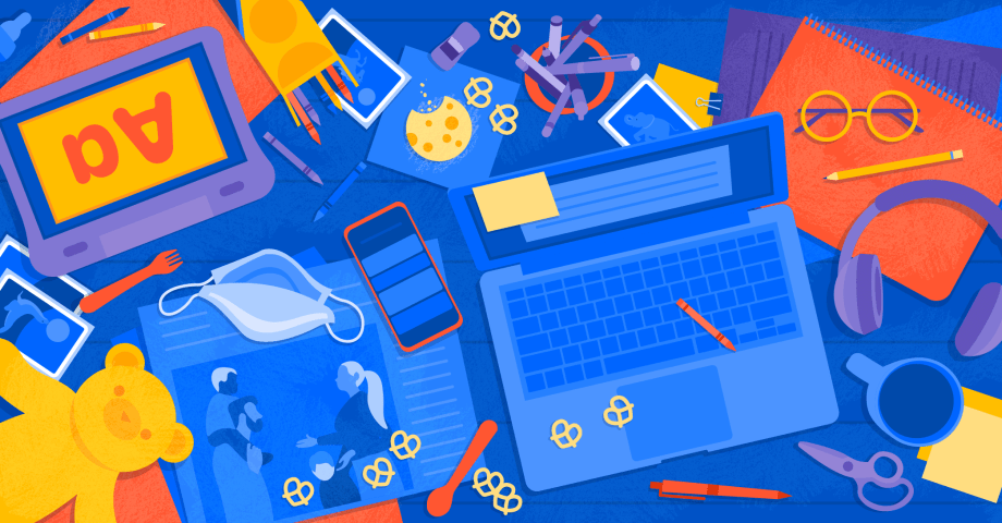 Laptop and children's toys on a desk, signifying parents working from home with children