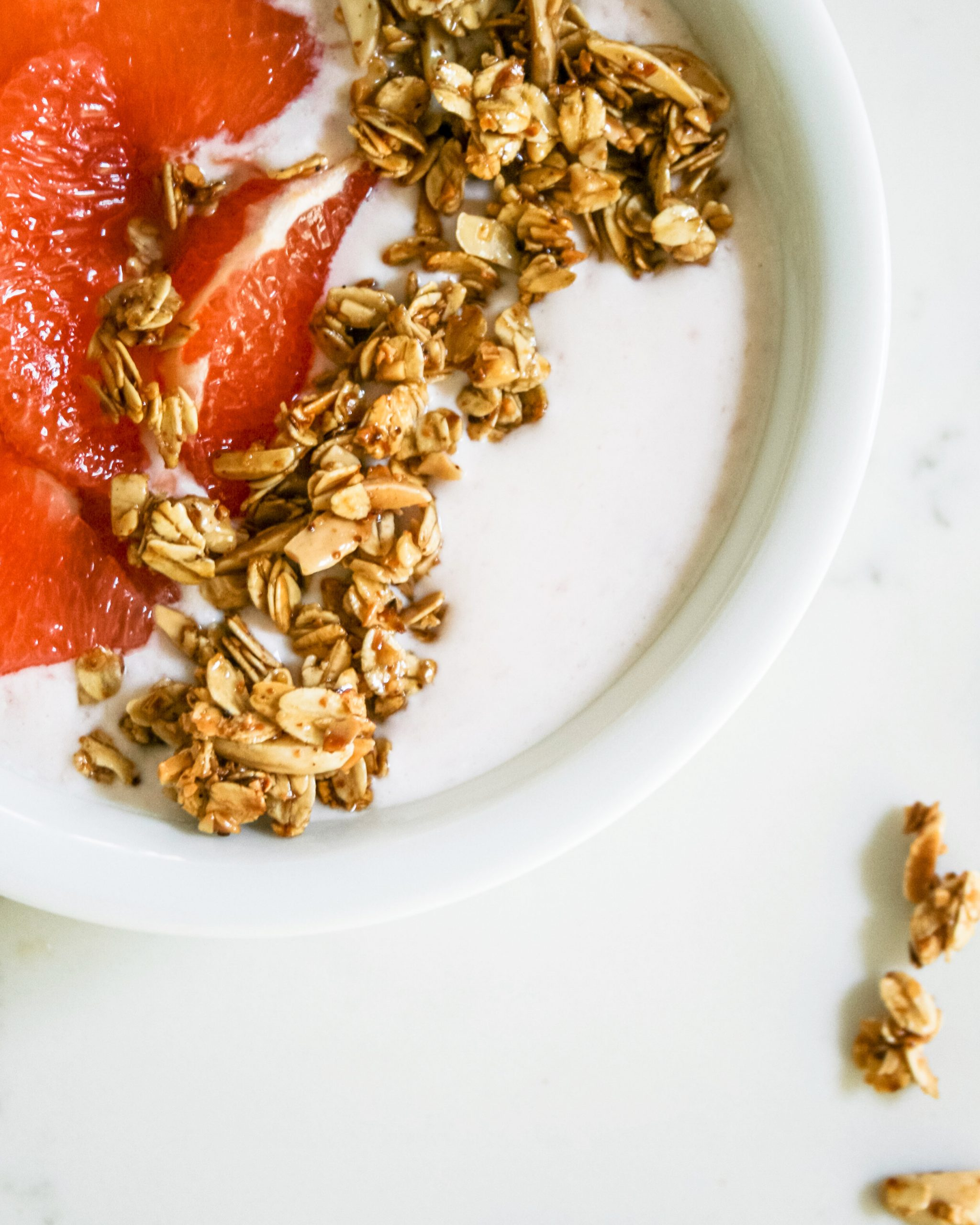 Food photography of Greek yogurt bowl with grapefruit and granola