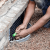 Installing an ATMOX foundation fan or vent cover.