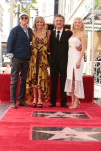 Boston Russell, Goldie Hawn, Kurt Russell and Kate Hudson seen at Goldie Hawn and Kurt Russell honored with a double star ceremony on the Hollywood Walk of Fame on Thursday, May 4, 2017, in Los Angeles. (Photo by Eric Charbonneau/Invision for Twentieth Century Fox/AP Images)