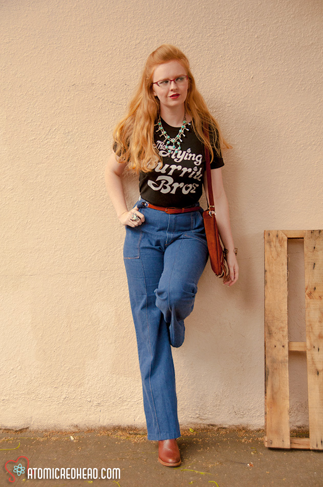Flying Burrito Brothers tee with 70s jeans and a turquoise squash blossom.