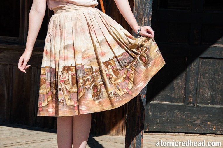 A close up of my skirt, which features a western town.