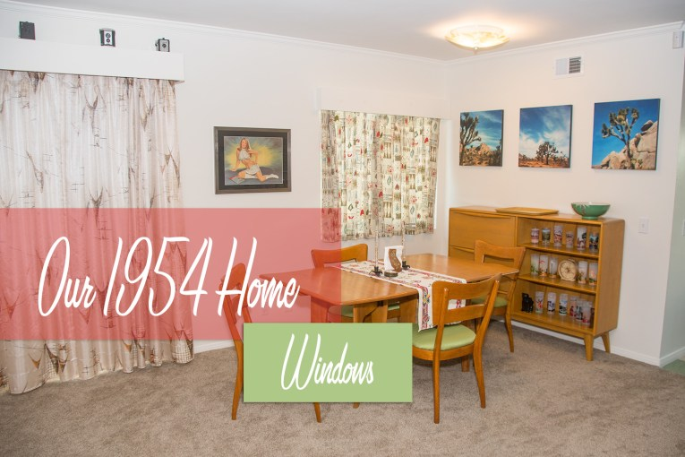 """A view into our dining room, with a warm maple table and matching chairs, which feature a pale green upholstered seat. Photographs of Joshua Tree hang on the wall. Text is overlay reads """"Our 1954 Home Windows"""""""