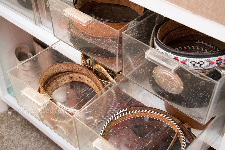 Belt storage in clear plastic drawers