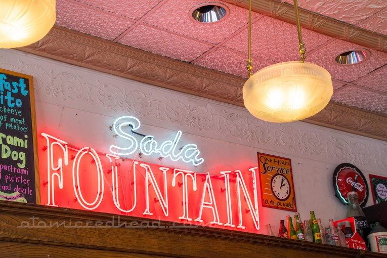 "Interior neon reading ""Soda Fountain"""