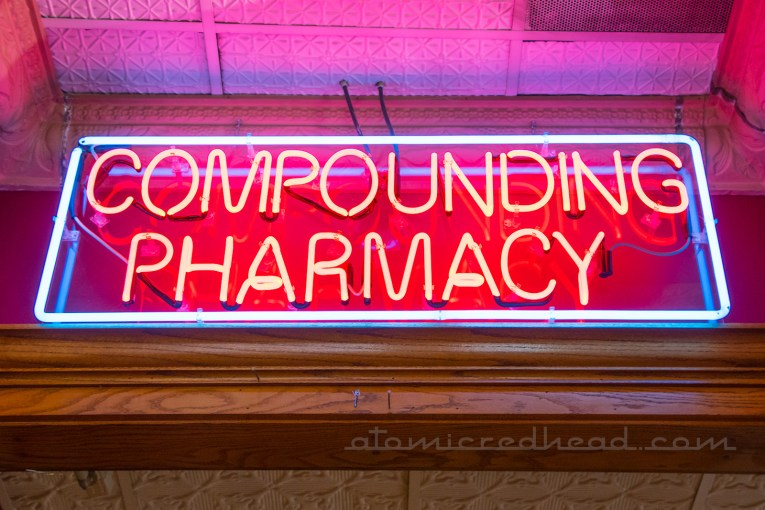 "Interior neon reading ""Compound Pharmacy"""