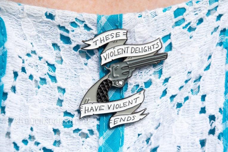 "Close up of my Westworld pin - a revolver reading ""These Violent Delights Have Violent Ends"""