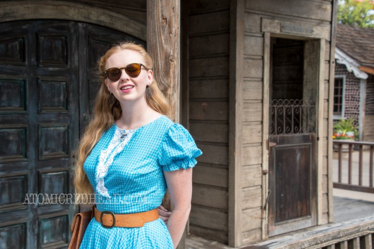 My outfit for the day- A blue dress with white lace trim, tooled leather belt, with tooled leather pouch.