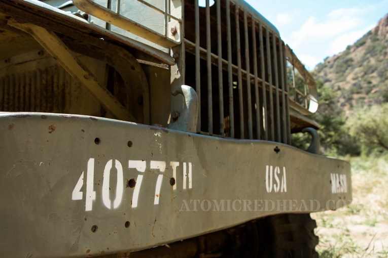 "Close up of the bumper of the painted ambulance with ""4077th"""