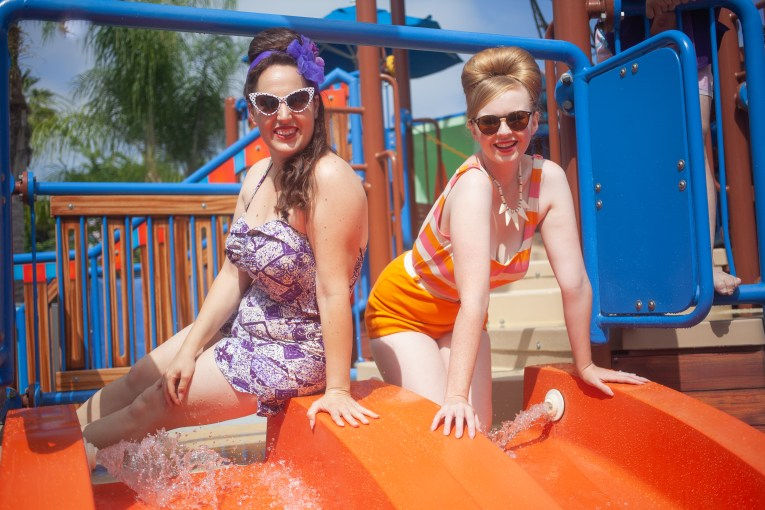 Me, in a vintage orange, pink, and white swimsuit, and my friend Kiley in a vintage purple floral swimsuit