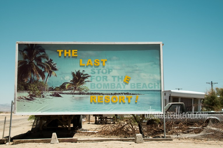 """Art Installation - a faux billboard reading """"The Last Stop For The Bombay Beach Resort"""" but with most of the letters fallen off, so it reads more like """"The Last Resort"""""""
