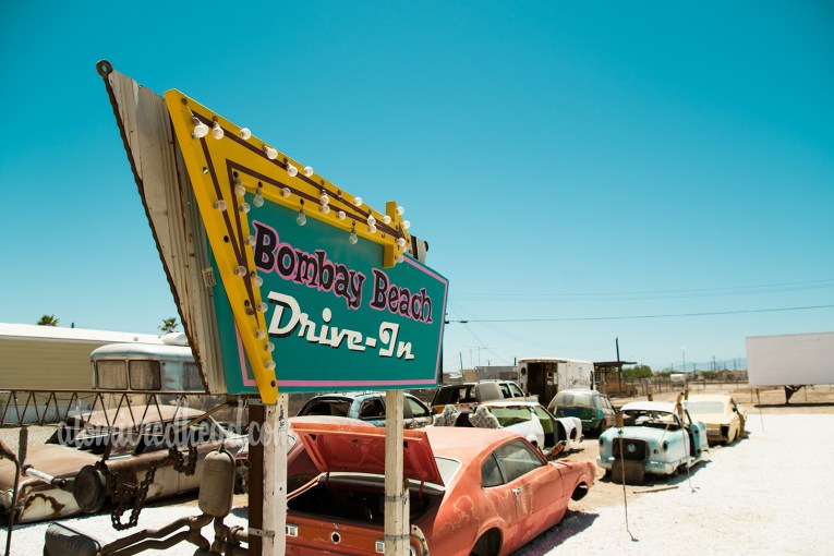 Art Installation - The Bombay Beach Drive-In, a faux drive-in with old, junk cars and a large trailer painted white to emulate a screen.