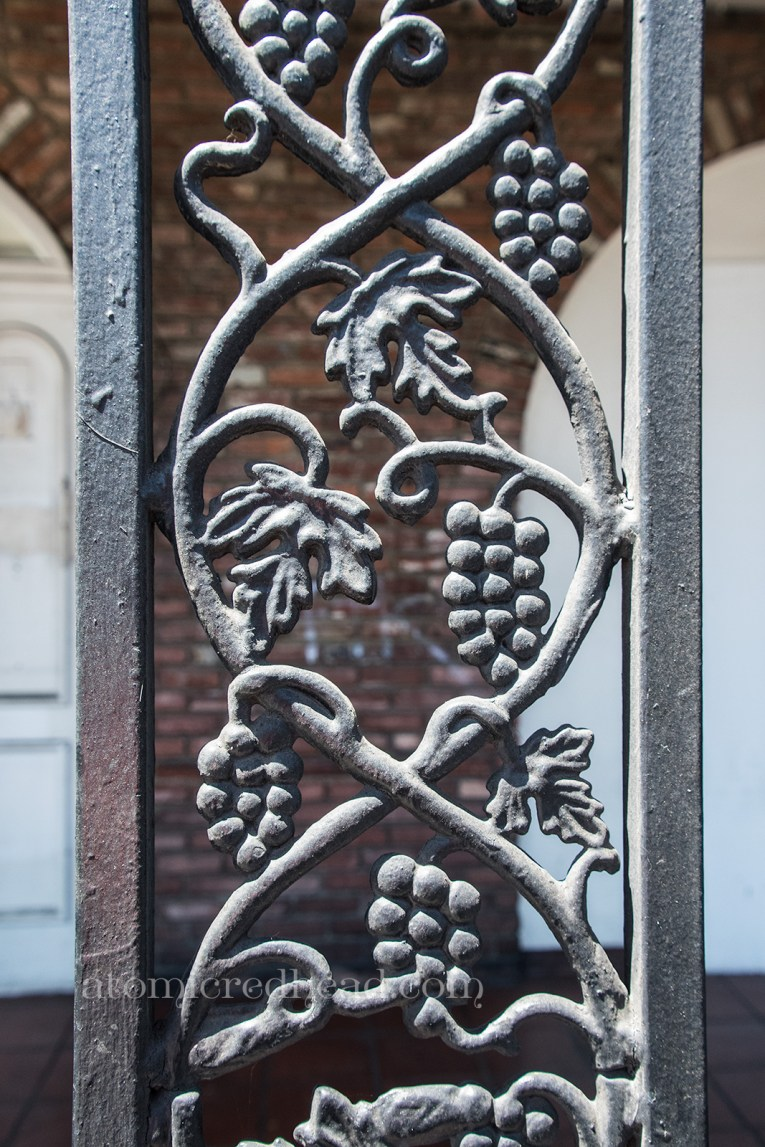 Close-up for the wrought iron, featuring leaves and grapes.