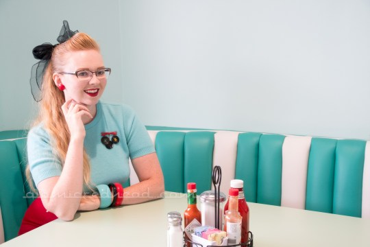 Me sitting at one of the gorgeous turquoise and white booths.