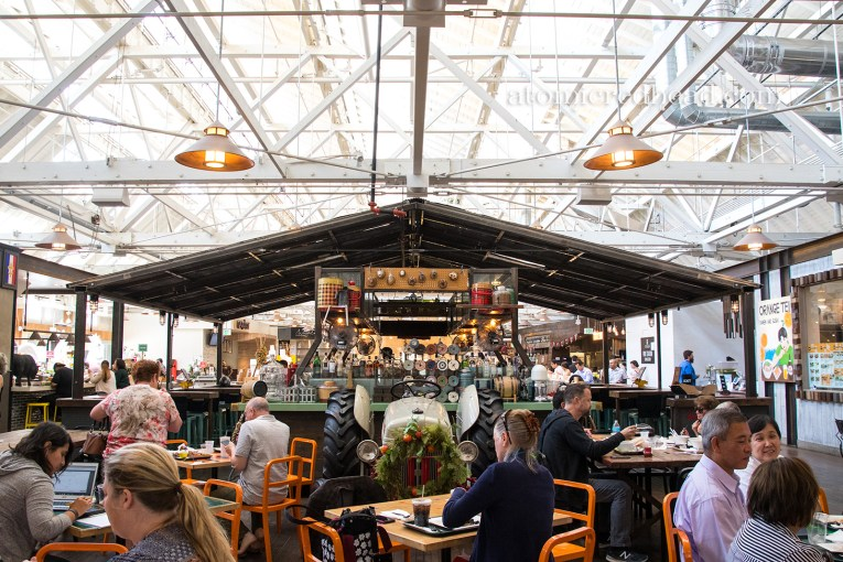 Inside the Packing House, tables abound with various restaurants around the edge.