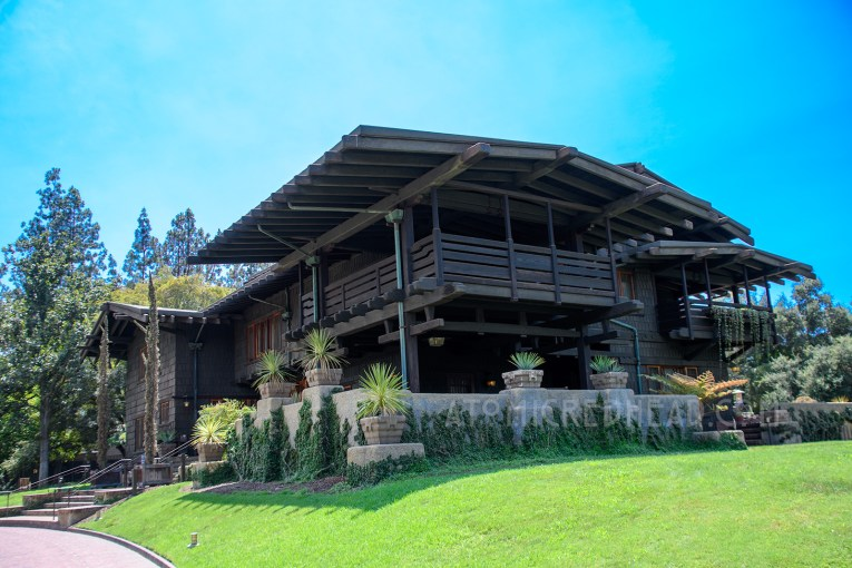 Exterior of the Gamble House, a three story Craftsman style house, with two large sleeping porches, and overhangs.