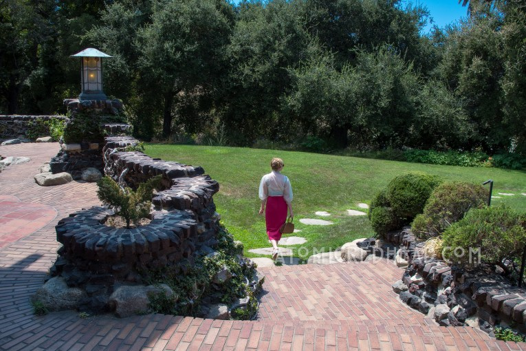 Walking away from the Gamble House on their trail of stones through the gress.