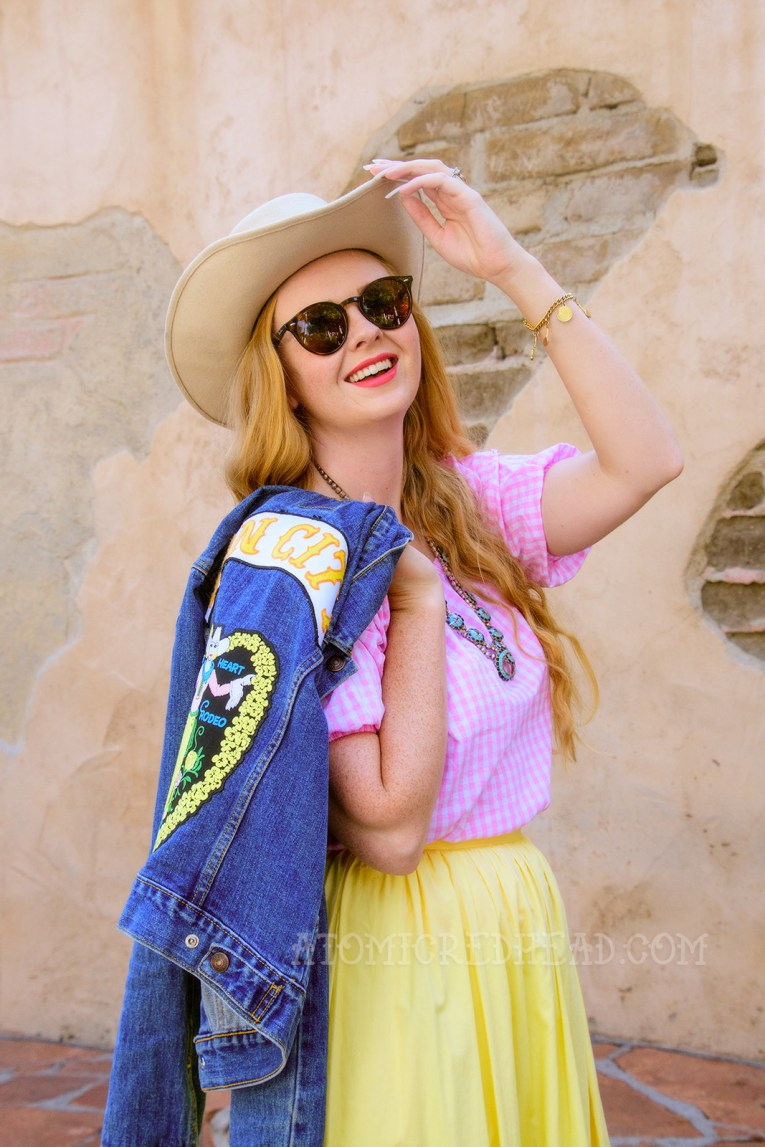 "Inspired by the Sweetheart of the Rodeo, a cream cowboy hat, pink and white gingham peasant top, butter yellow skirt, and cowboy boots, plus a jean jacket featuring patches reading ""Sin City"" and the artwork of the album, a cowgirl with a ring of yellow flowers around her."