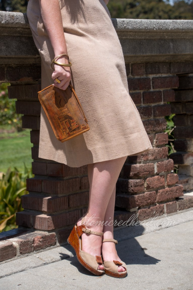 Close up of my shoes and purse. Purse is a leather clutch with a scene of ancient Egypt, with palm trees and pyramids. Shoes a faux alligator and brown suede.