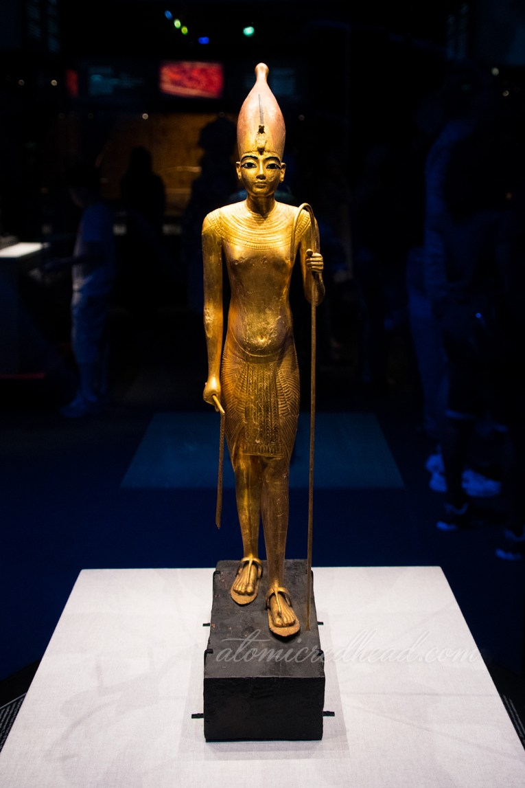 A small figure of Tut in gold.