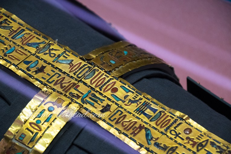 Close up of some hieroglyphics that were placed on his body, made of gold.