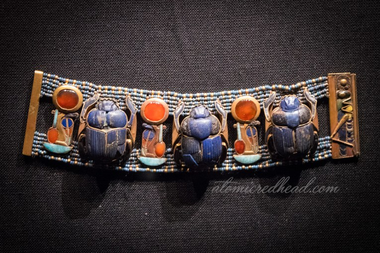 A bracelet featuring scarabs.
