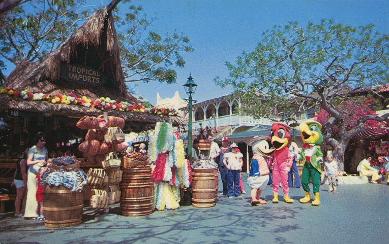 The Three Caballeros visit Tropical Imports, a tiki-esque shop in Adventureland with a high peaked thatch roof.