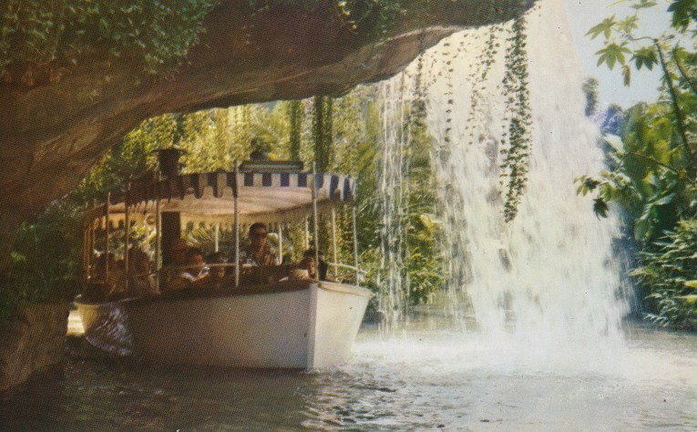 A Jungle Cruise boat sails under Schweitzer Falls.