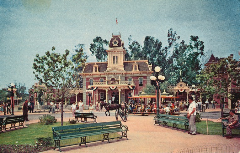 Disneyland's City Hall, which features a tower in the middle, and is made up of brick.