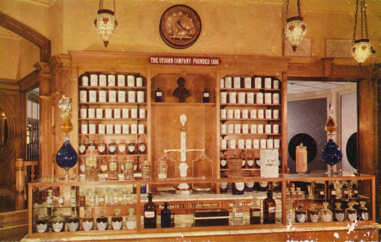 Inside the pharmacy, warm with light colored wood and cold bottles along the back.