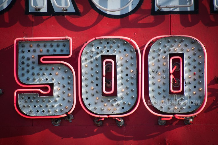 "Close-up of the neon ""500"" portion of the ""we have sold over 500 million"""