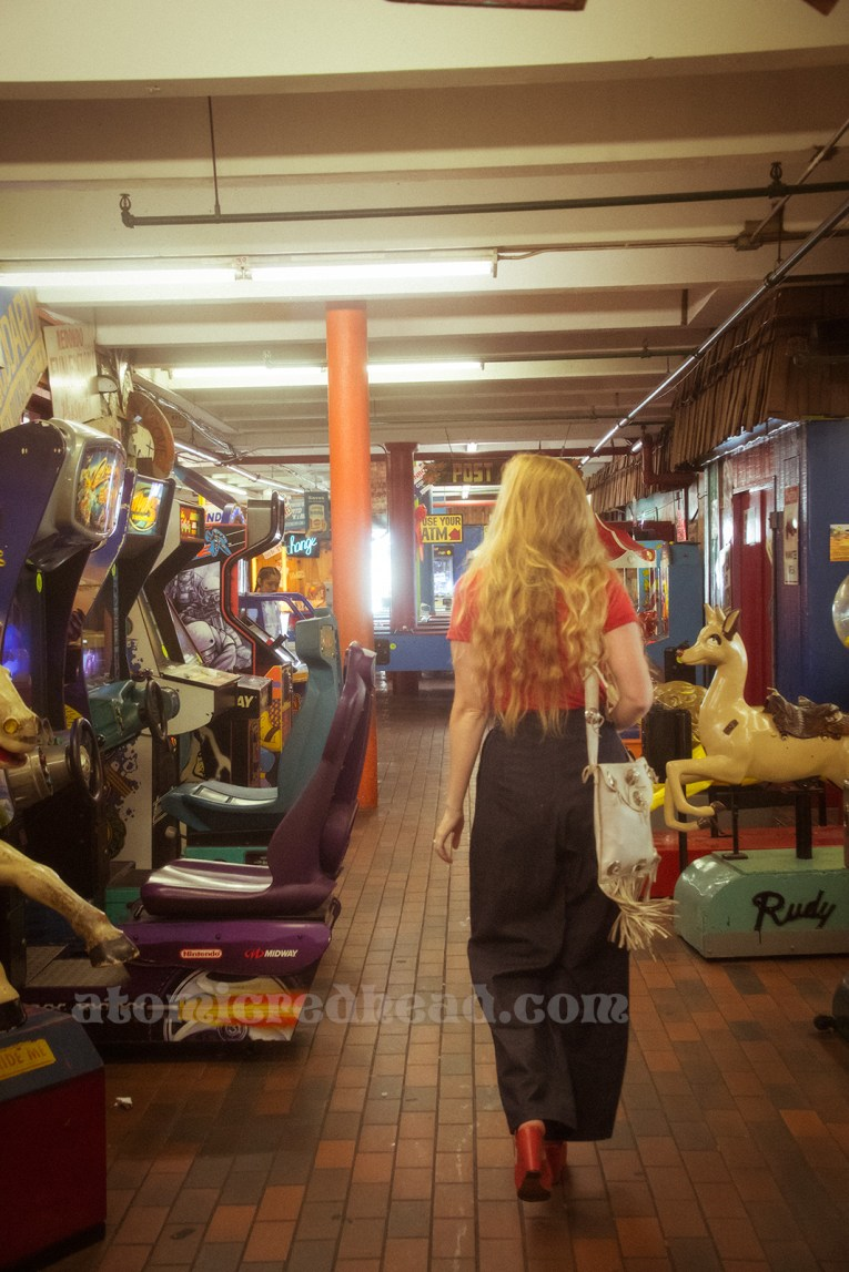 Walking through the Redondo Fun Factory, a variety of ride style games including a vintage Rudolph.