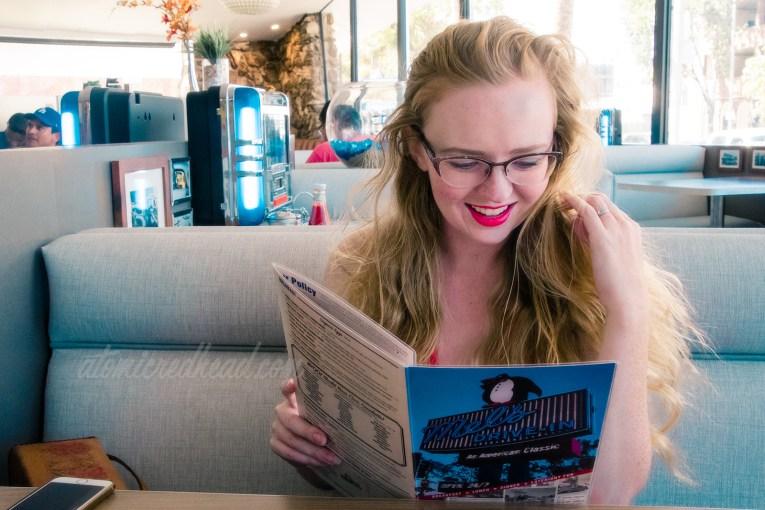 Me, reading the menu at Mel's.