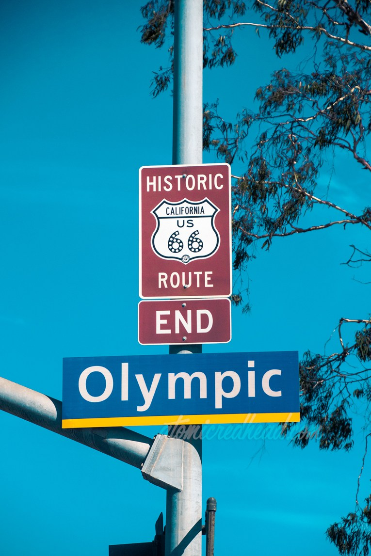 "The sign at the corner of Olympic and Lincoln reading ""Historic California US 66 Route End"""