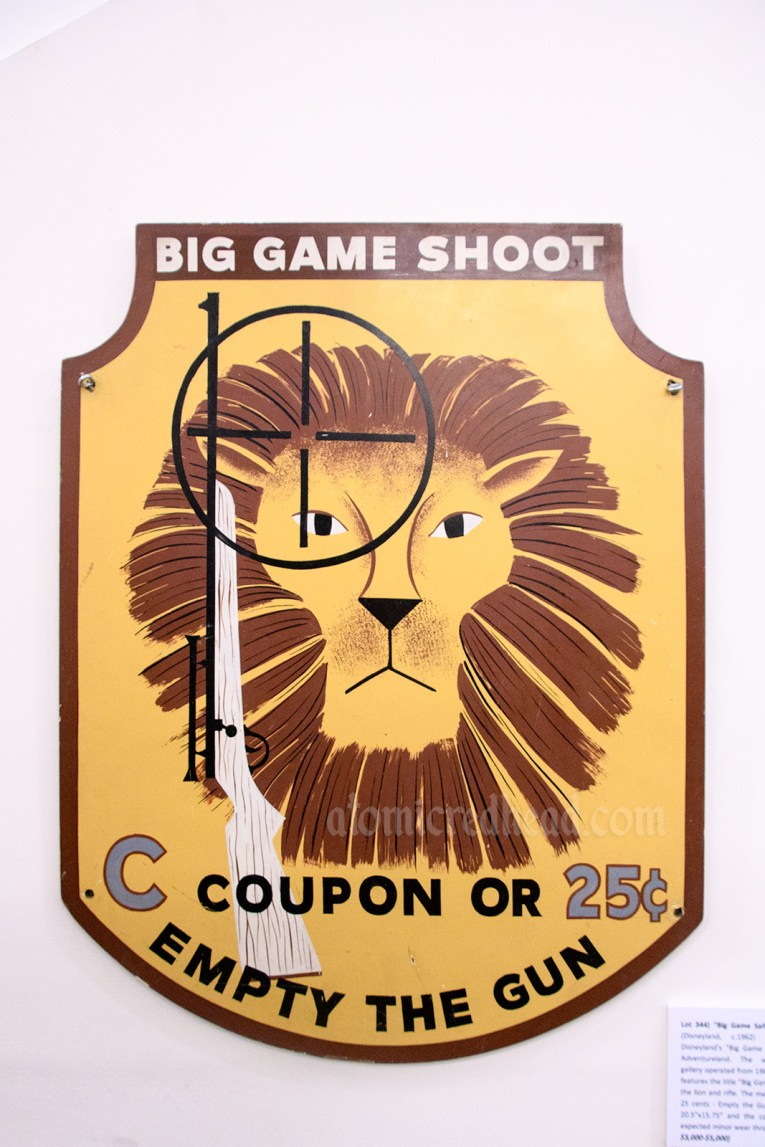 "Sign from the ""Big Game Shoot"" shooting gallery that was in Adventureland, and features a lion and gun. Also reads ""C Coupon or 25 cents Empty the Gun"""