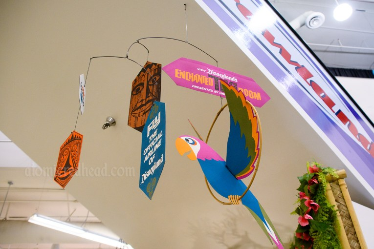 "Cardboard mobile for the Enchanted Tiki Room, multi-color, reading ""Fly the official airline of Disneyland"""