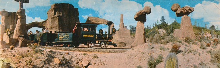 The Mine Train passes by boulders that teeter.