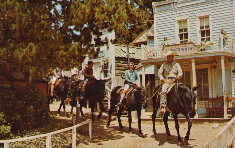 Guests ride burros through the faux old west town of Rainbow Ridge.