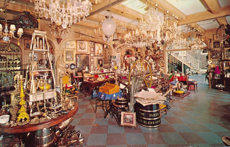 Inside the One-of-a-Kind Shop, with a variety of antiques, like chandeliers, statues, china, paintings, and more.