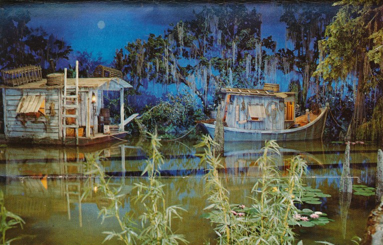 Interior of Pirates - two house boats sit in a bayou, Spanish Moss hangs from low willows, the moon shines in the distance.