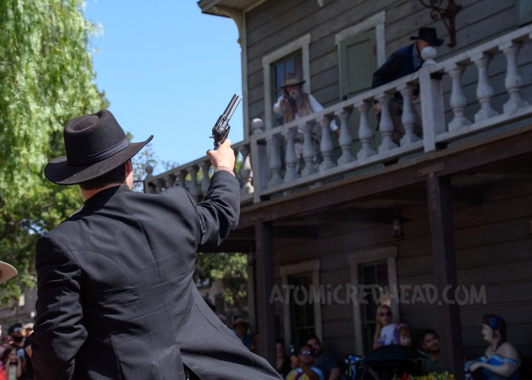 Deputy Stillwater aims at some of the Mayfield gang as they run across the balcony of the Calico Saloon.